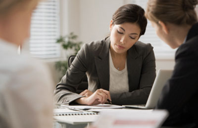 Businesswoman-Taking-Notes-with-Woman-Client